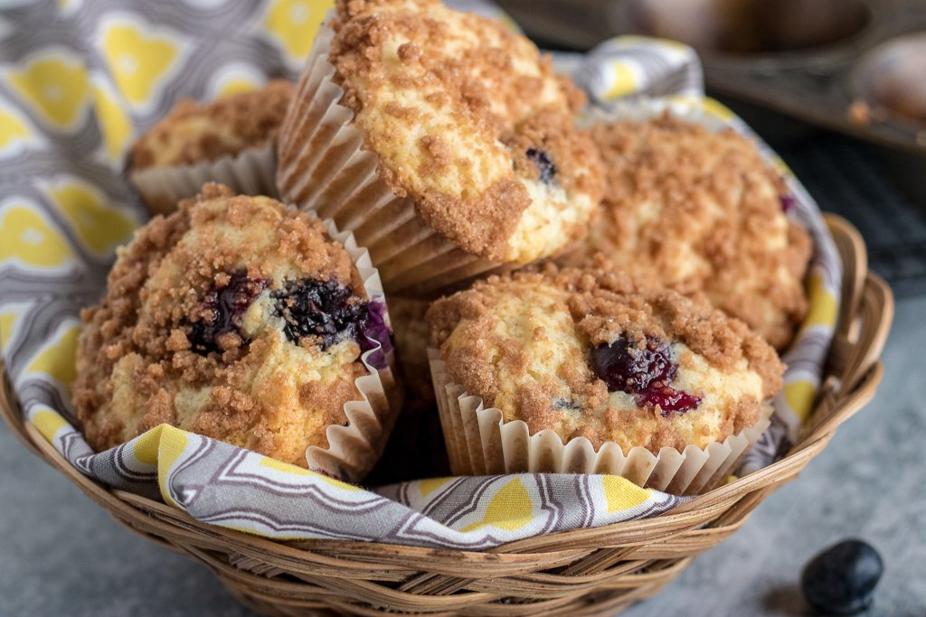 blueberry crumb muffins in a basket