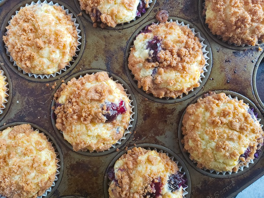 blueberry crumb muffins in the pan