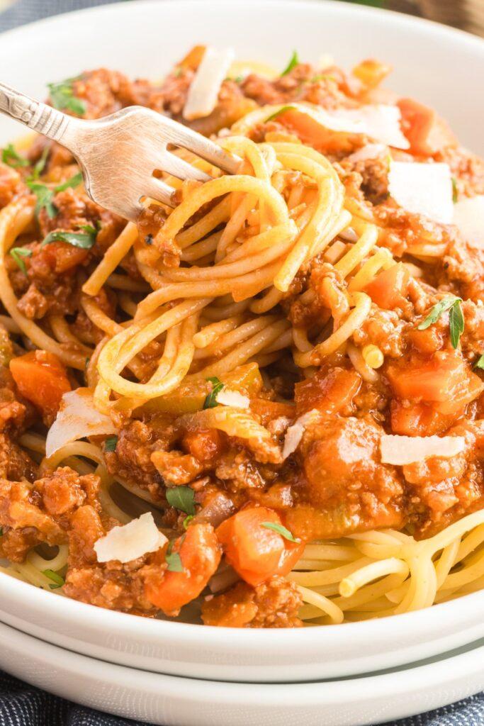 spaghetti bolognese twirled on a fork