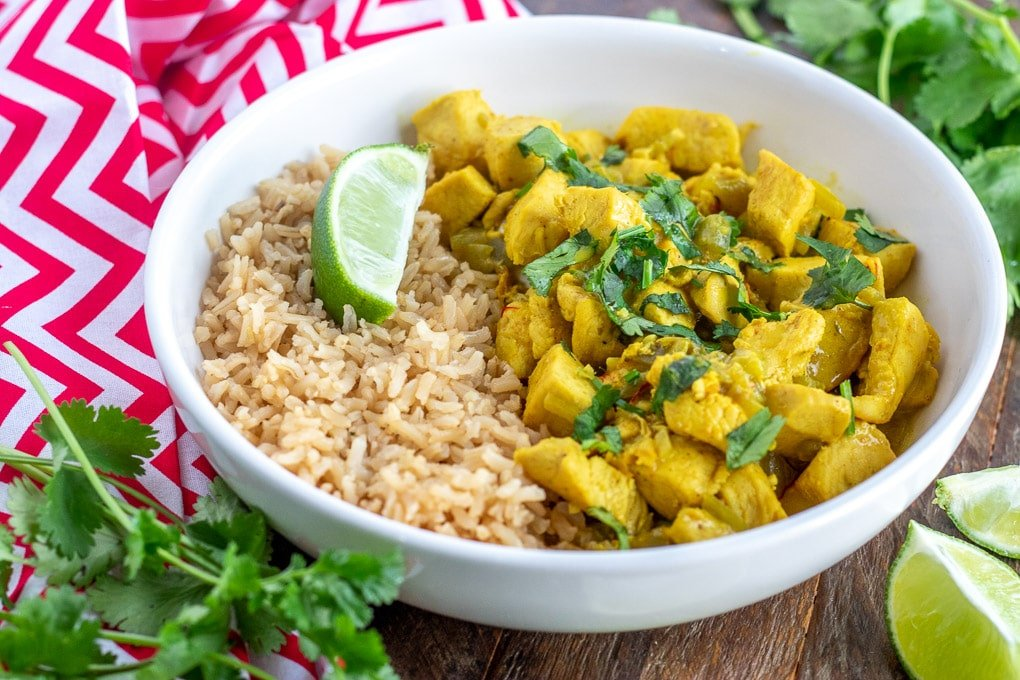 White Bowl with Coconut Chicken Curry, Rice, Cilantro & a Lime Wedge