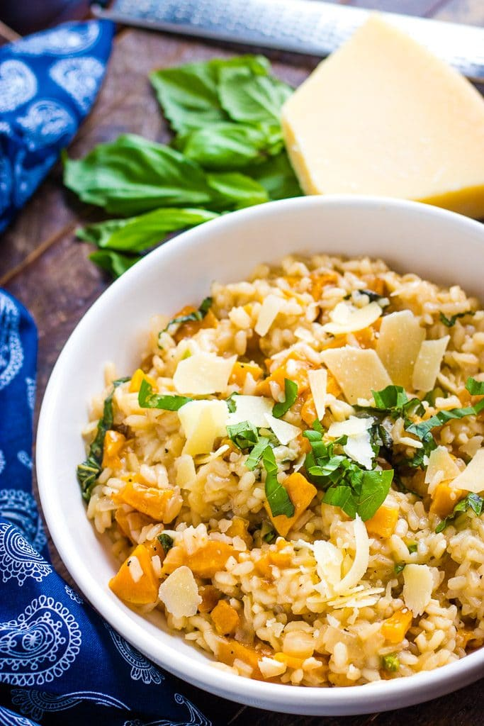 Detail shot of roasted squash risotto in white bowl.