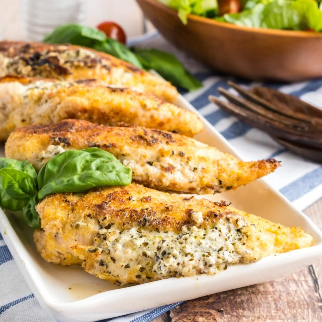 square picture of stuffed chicken breasts on a platter