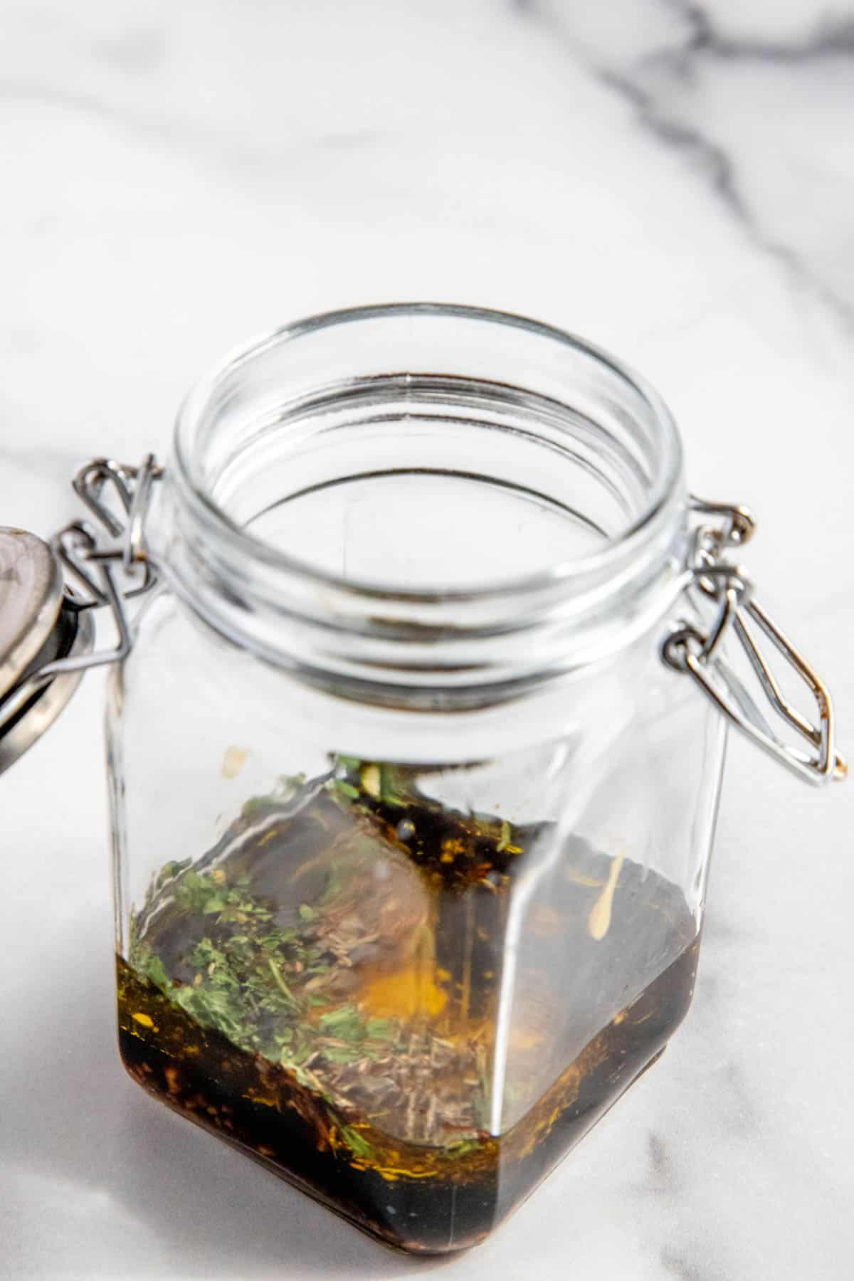 mustard vinaigrette ingredients in a glass jar before shaking