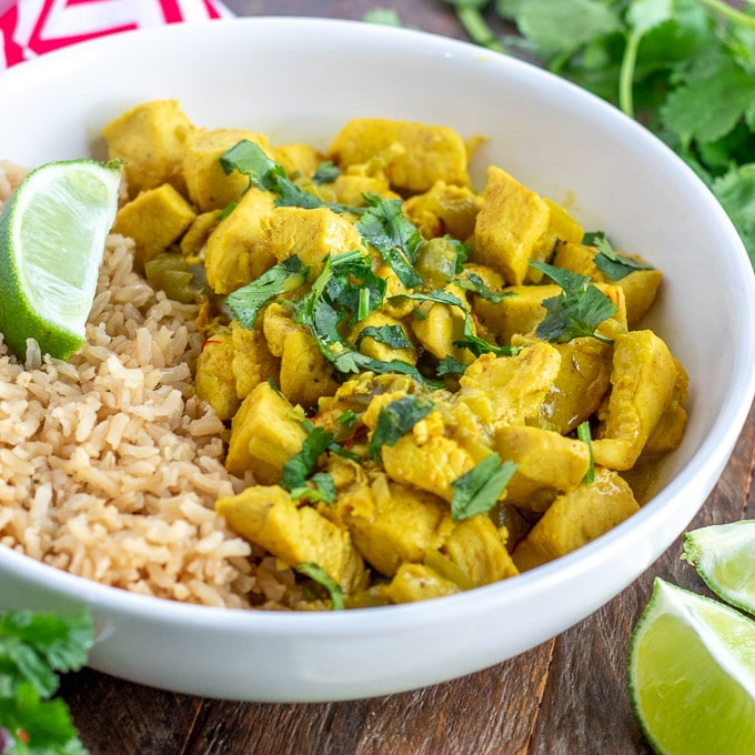 Coconut Chicken Curry - square, white bowl with limes