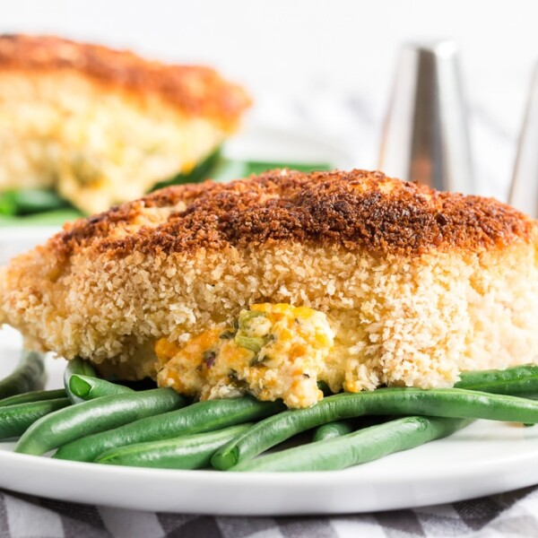 jalapeno popper chicken on top of green beans