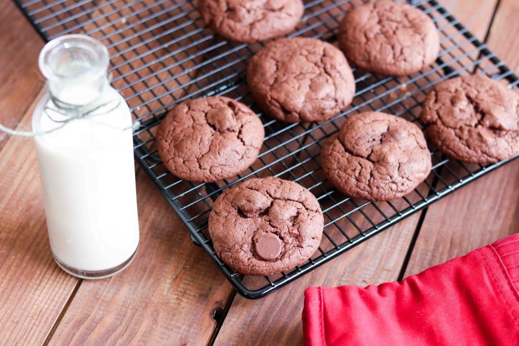 Chocolate Cake Mix Cookies (aka Cheater Cookies) horizontal cookies on rack with milk