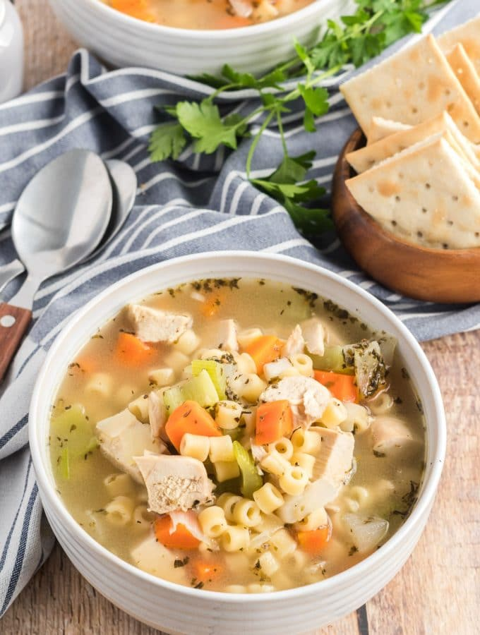 chicken noodle soup in a white bowl