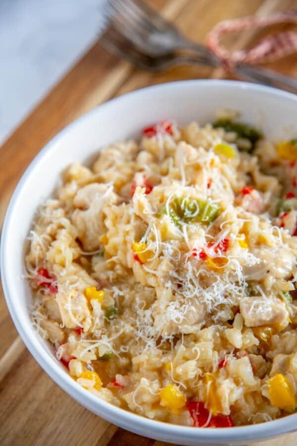 chicken risotto in a white bowl