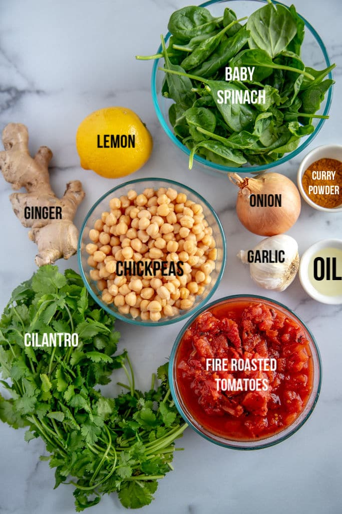 chickpea spinach curry with ingredients laid out