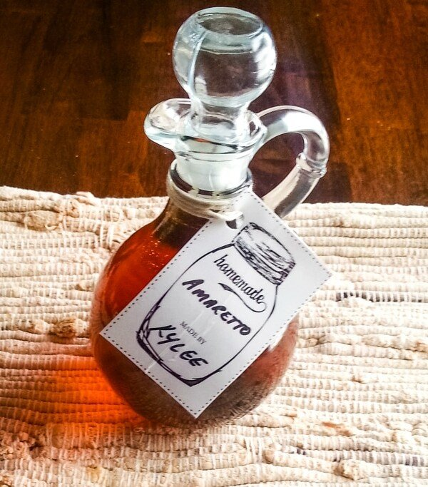 homemade amaretto in a glass bottle with stopper