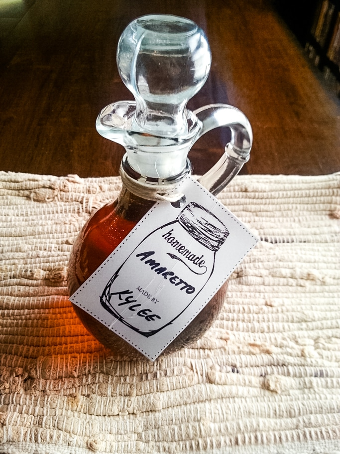 homemade amaretto in a cruet with a stopper and a label