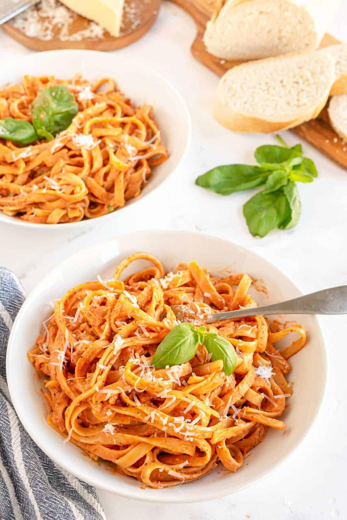 tomato cream sauce on pasta with basil