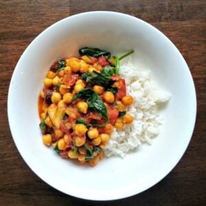 Chickpea, Tomato & Spinach Curry  in a white bowl