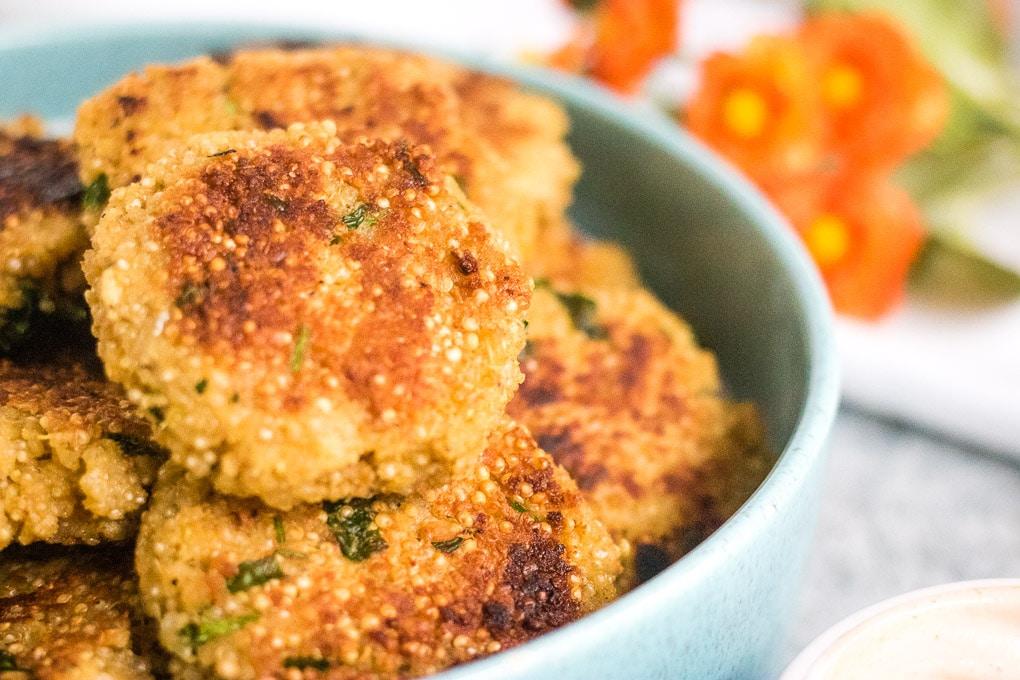 quinoa patties in a blue bowl