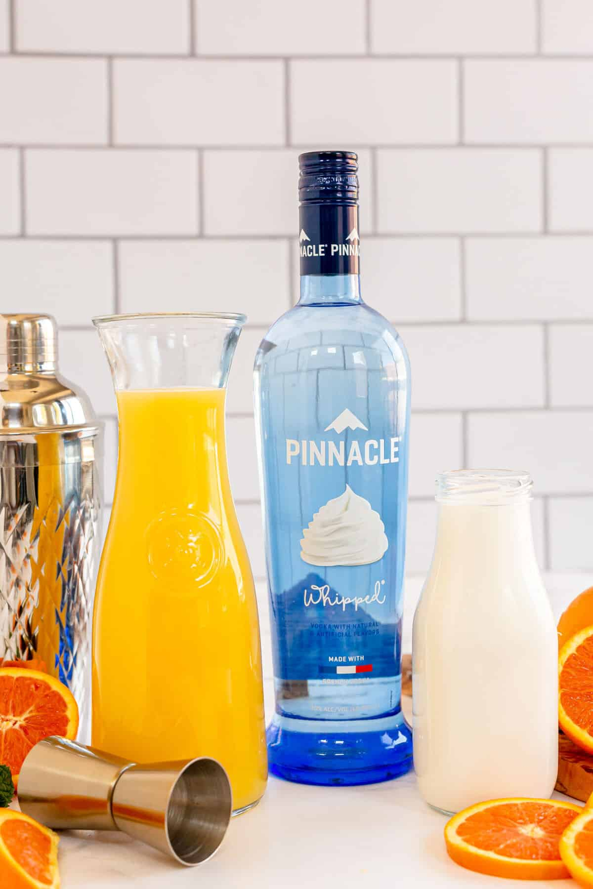 ingredients for how to make an orange creamsicle cocktail laid out