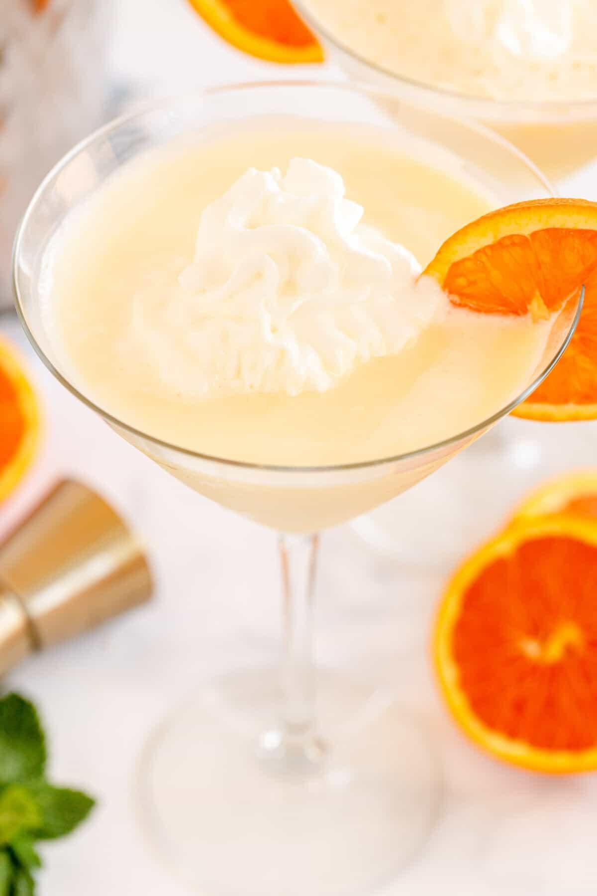 close up of orange creamsicle martini