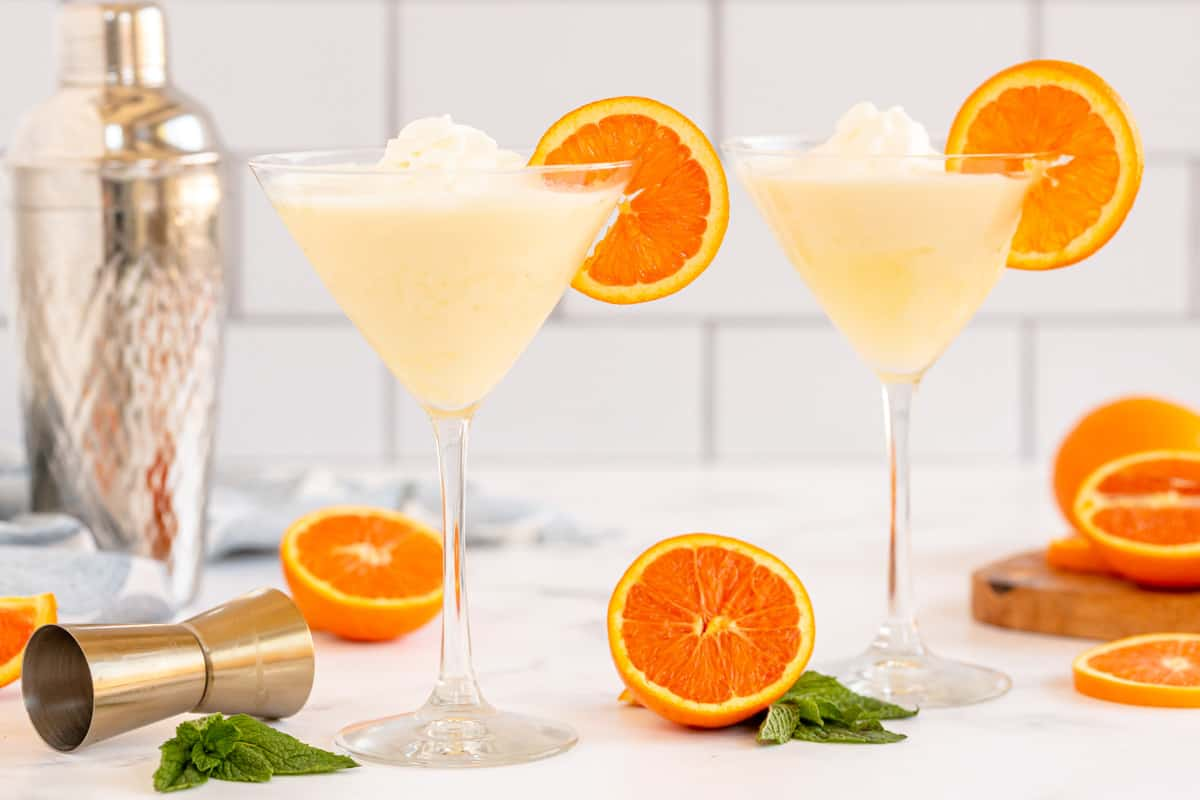 2 orange cream martinis with a cocktail shaker
