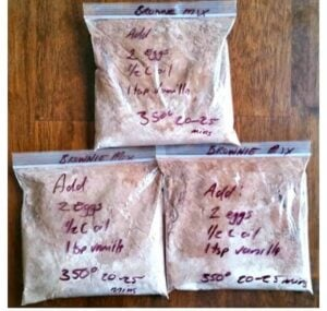 Homemade brownie mix in baggies with wet ingredients notated on the bag for easy baking.