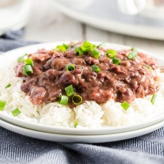 red beans and rice on a white plate with a blue napkin