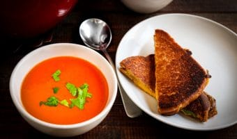 Easy Homemade Tomato Soup Recipe - horizontal, in bowl with grilled cheese