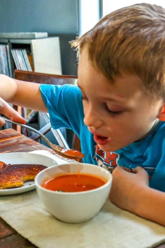 boy eating tomato soup