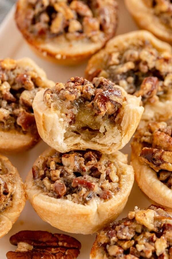 mini pecan pies on a white platter