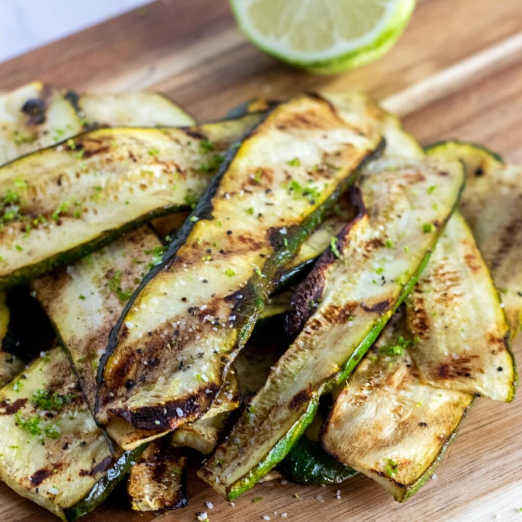 grilled zucchini on a chopping board