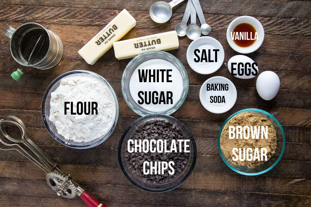 Chocolate chip cookie ingredients on wooden board