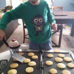 little boy flipping mini pancakes