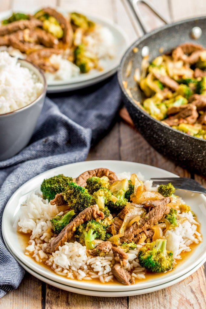 Beef and Broccoli on a white plate with rice