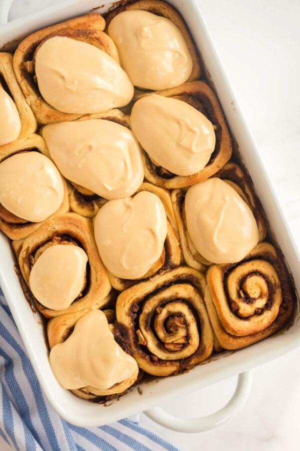 caramel apple cinnamon rolls in a baking dish
