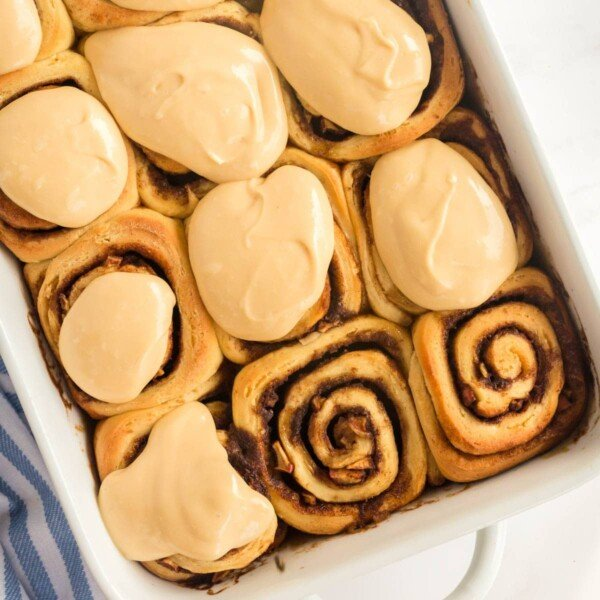 cinnamon rolls in a white baking dish