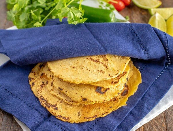 corn tortillas in a blue cloth napkin