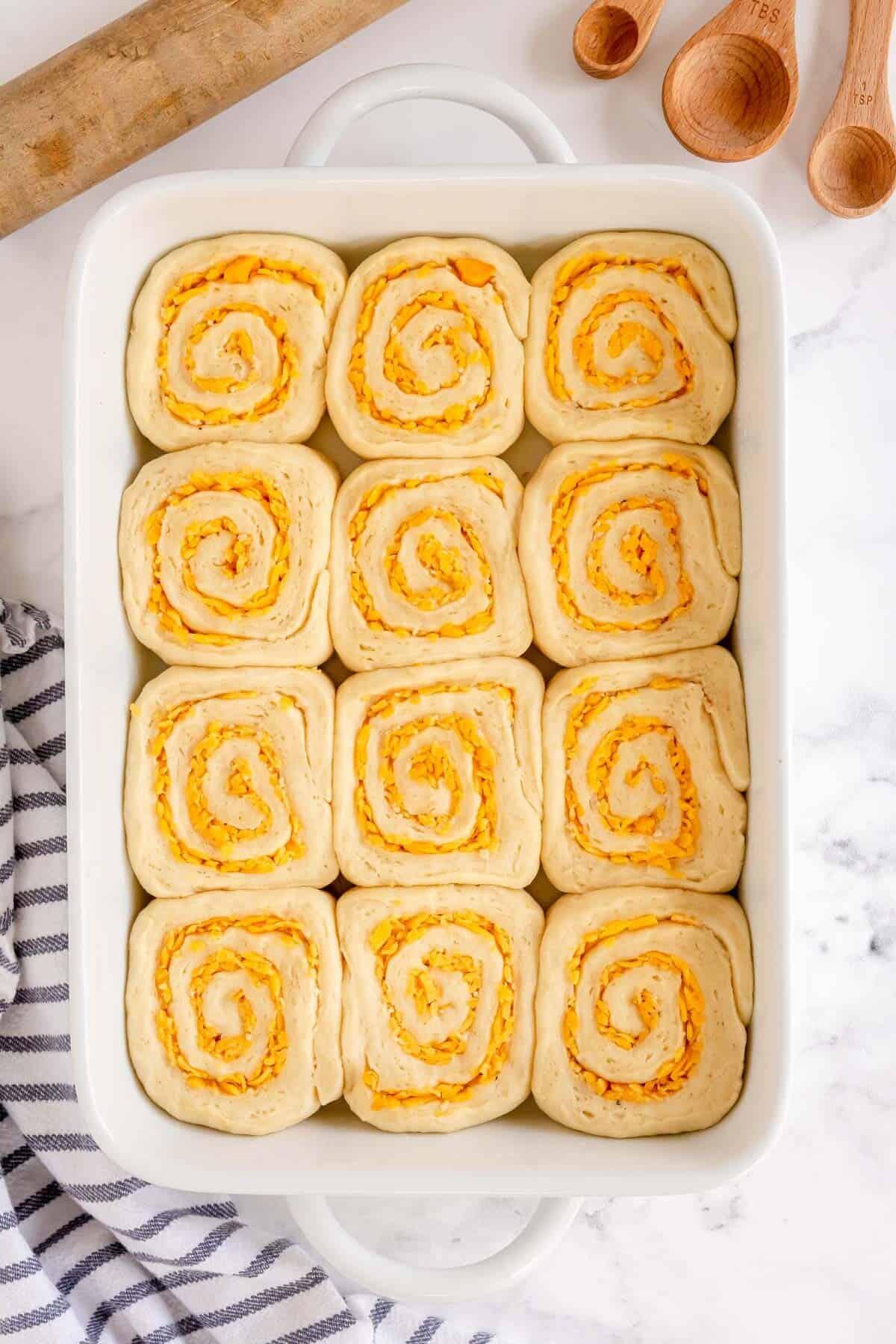 fully risen garlic rolls ready to bake