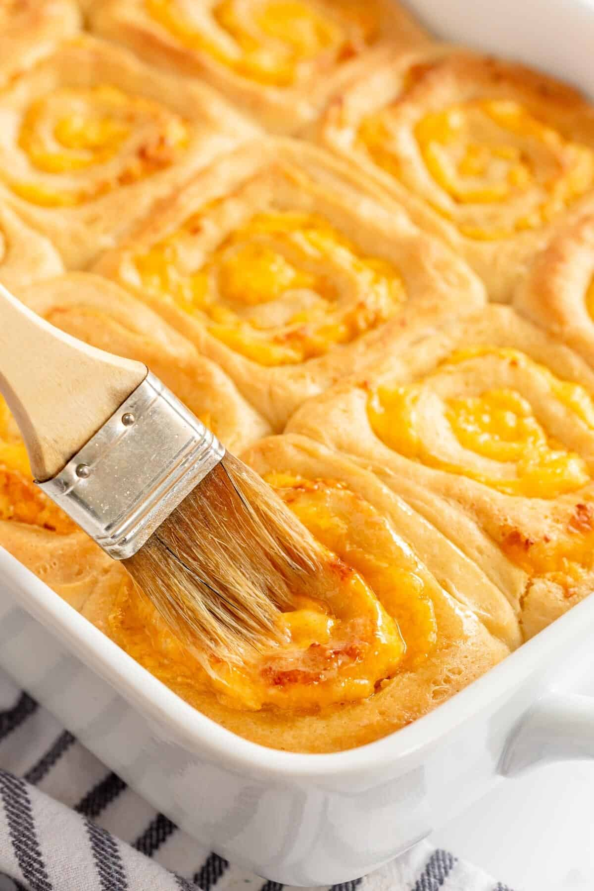 Garlic Cheese Bread with a pastry brush and butter