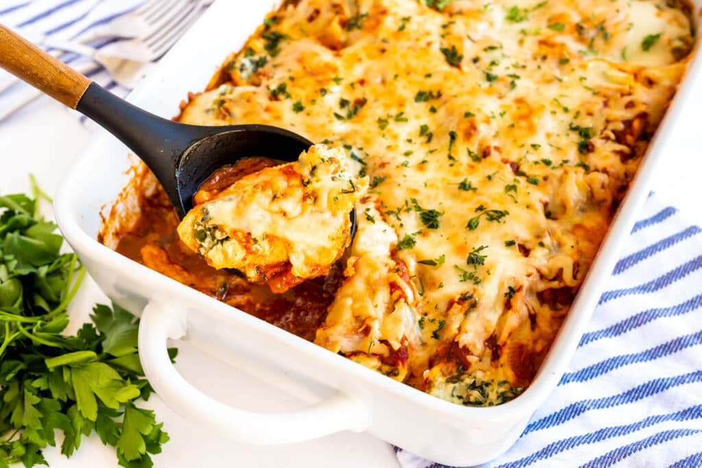 sausage stuffed shells in a white casserole