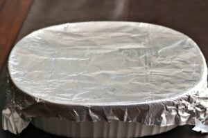 scalloped potatoes in a baking dish covered with foil