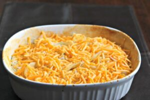unbaked scalloped potatoes in a baking dish