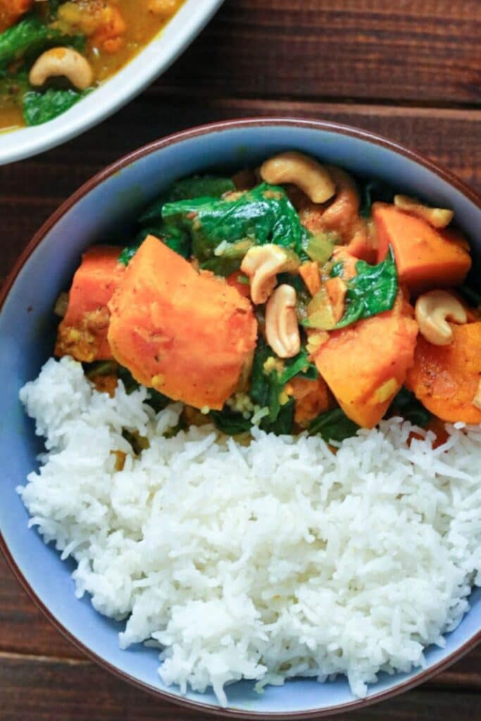sweet potato curry with rice in a blue bowl