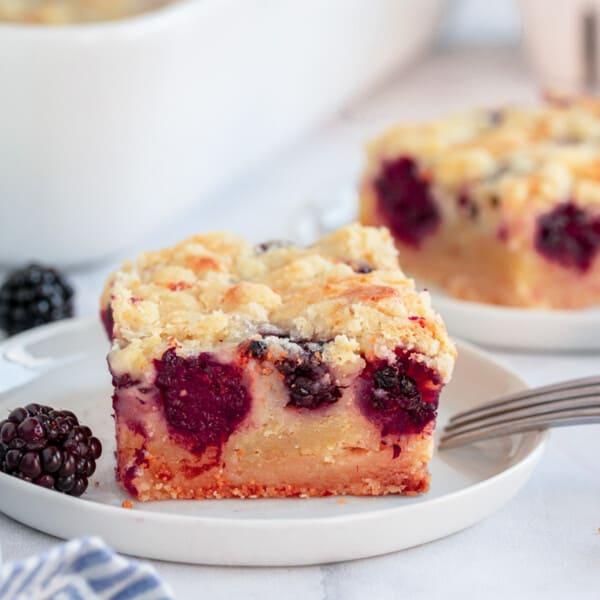 blackberry pie bars on a white plate