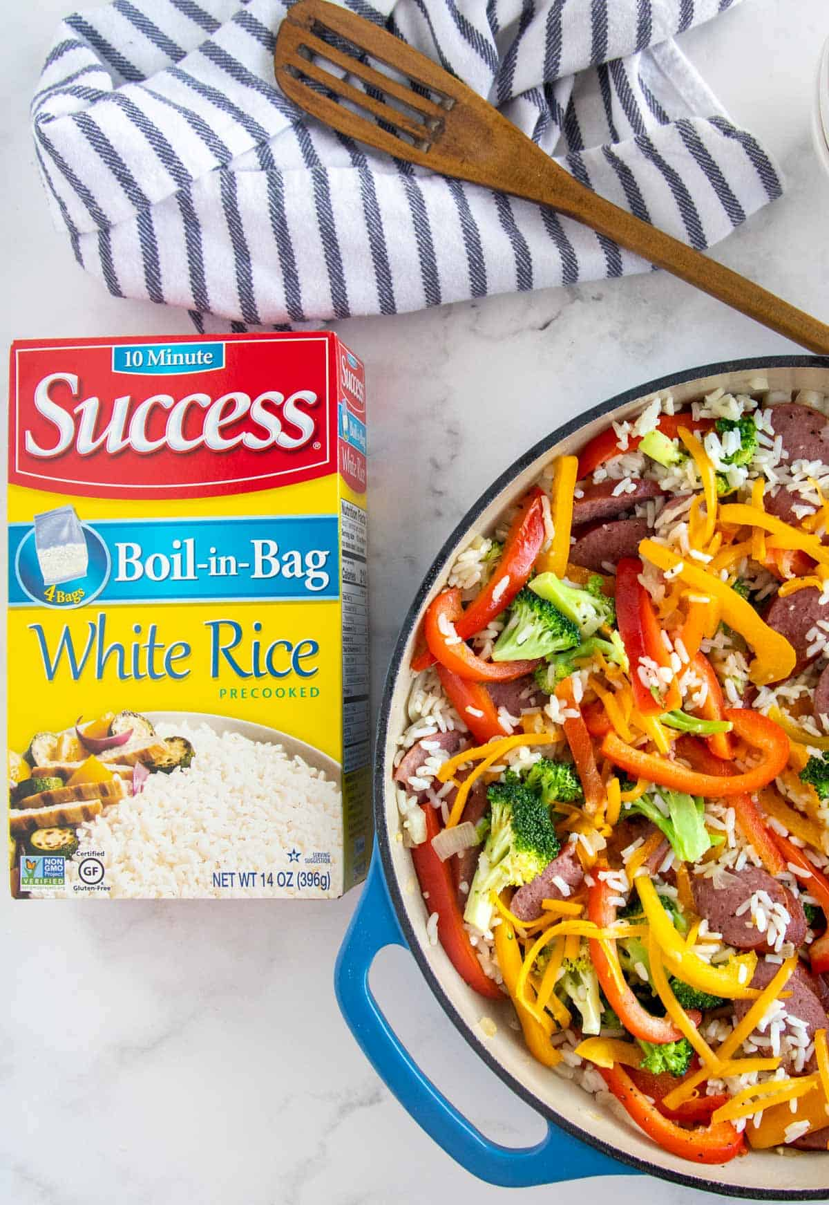 sausage and rice in a blue skillet