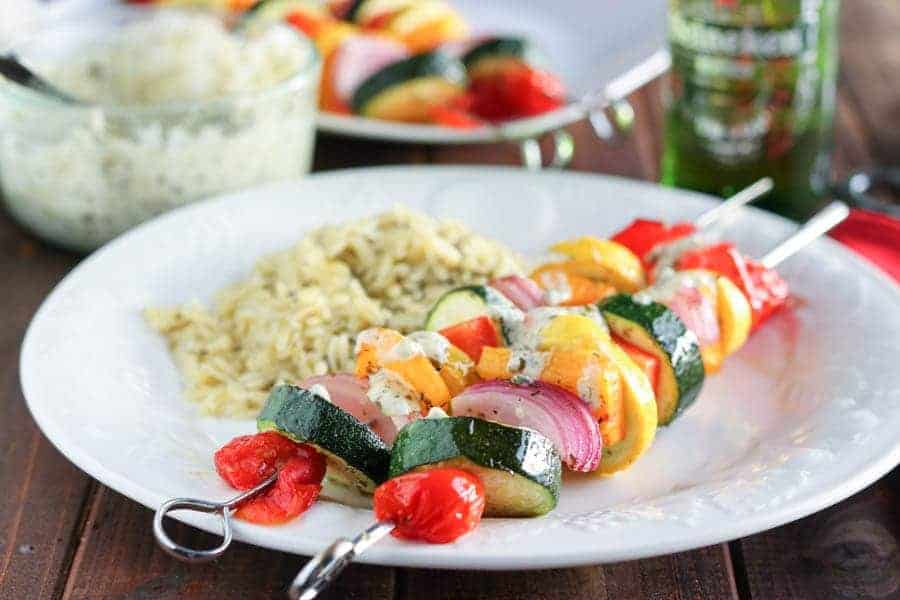A quick marinade, then threading on skewers takes these summery grilled vegetable kabobs with pesto yogurt sauce to a new level of delicious!