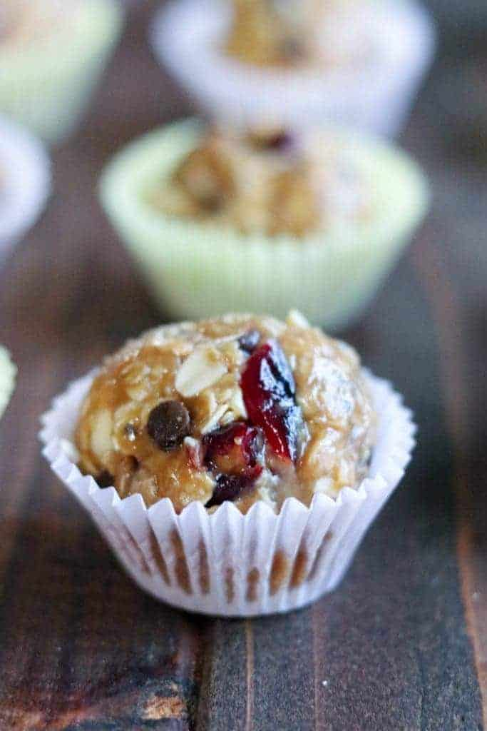 No Bake Cranberry Chocolate Granola Bites in paper cups