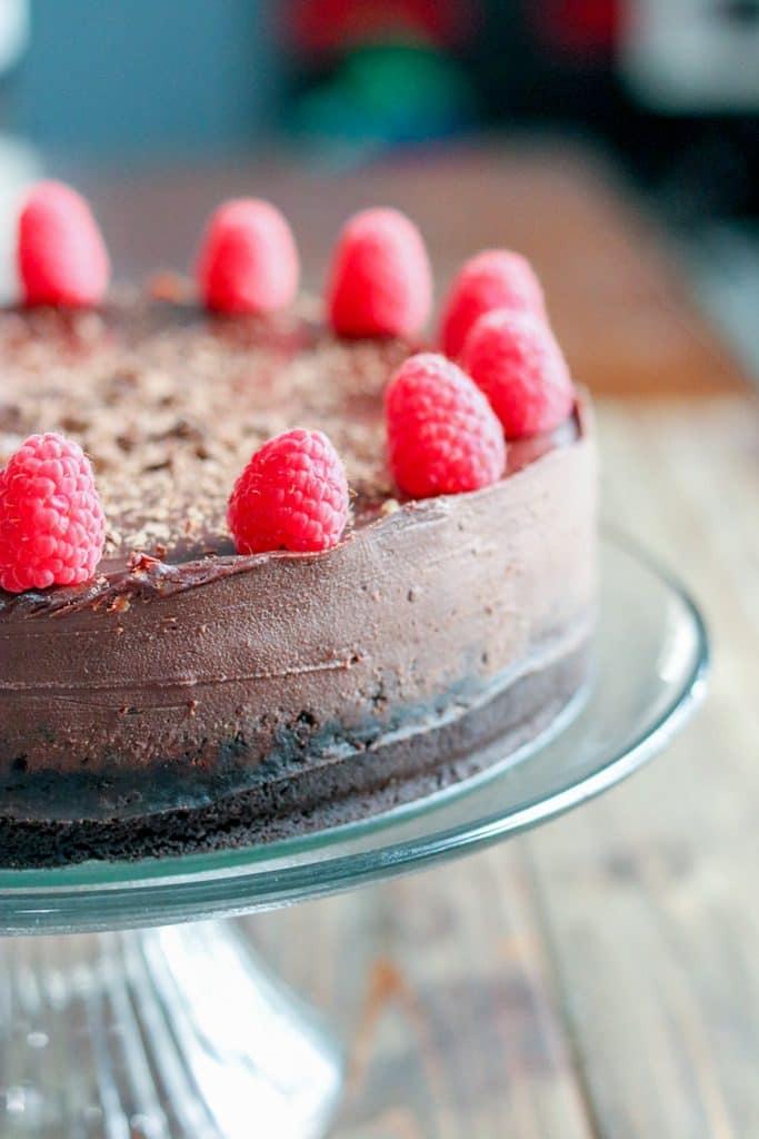 chocolate cheesecake decorated with raspberries