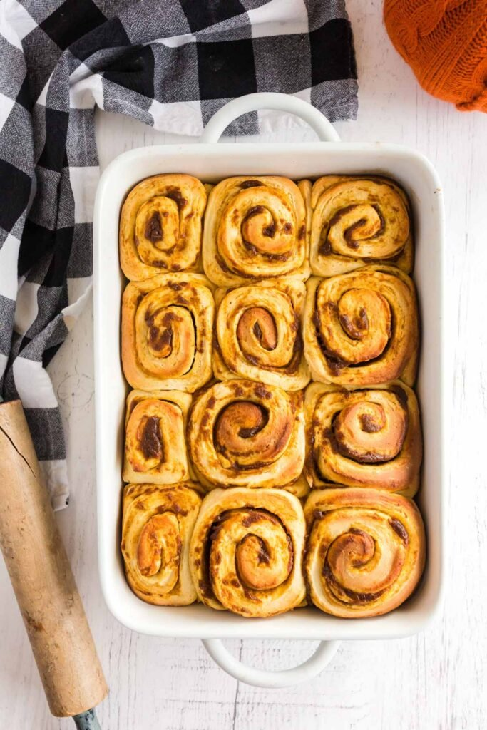 baked cinnamon rolls in a white dish