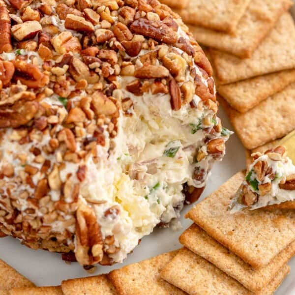 ham and pineapple cheese ball on a plate with crackers
