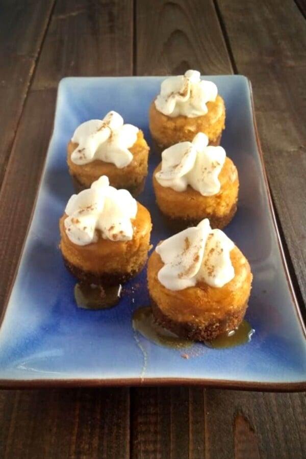 Mini Pumpkin Cheesecakes on a white platter