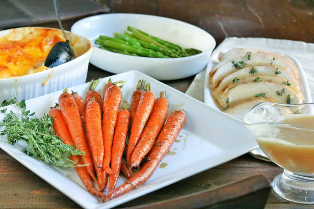 An easy solution to holiday cooking!! I have you covered with these delicious Bourbon Glazed Roasted Carrots!