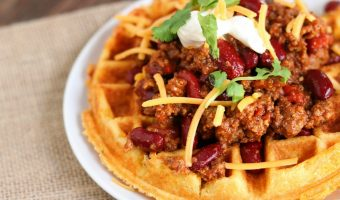 A fresh take on your traditional waffle, these savory Crispy Cheddar Cornbread Waffles are the perfect vehicle for chili, and so much fun to eat!