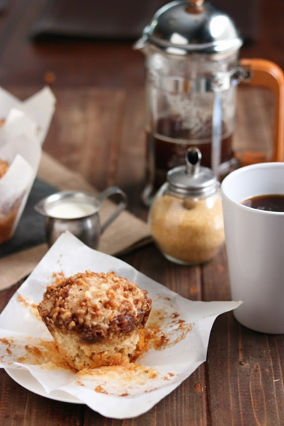 coffee cake muffins with coffee in the background